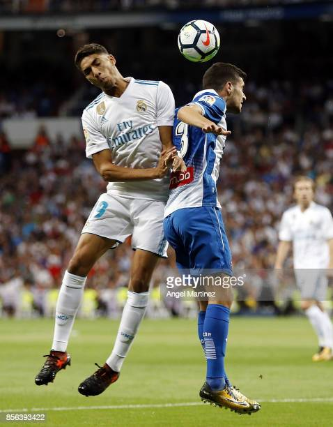 Achraf Hakimi of Real Madrid competes for the ball with Aaron Martin of Espanyol during the La Liga match between Real Madrid and Espanyol at Estadio...