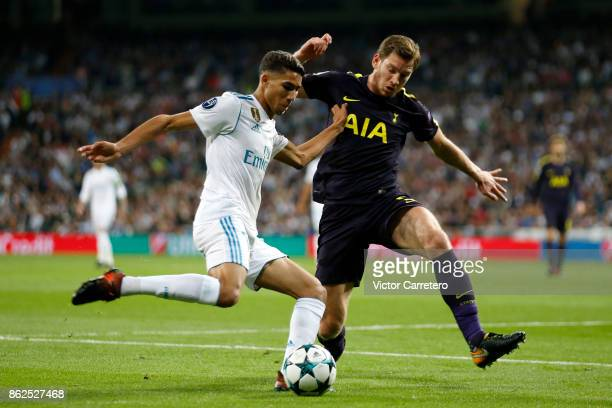 Achraf Hakimi of Real Madrid competes for the ball with Jan Vertonghen of Tottenham Hotspur during the UEFA Champions League group H match between...