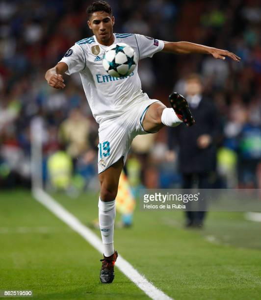 Achraf Hakimi of Real Madrid controls the ball during the UEFA Champions League group H match between Real Madrid CF and Tottenham Hotspur at Estadio...