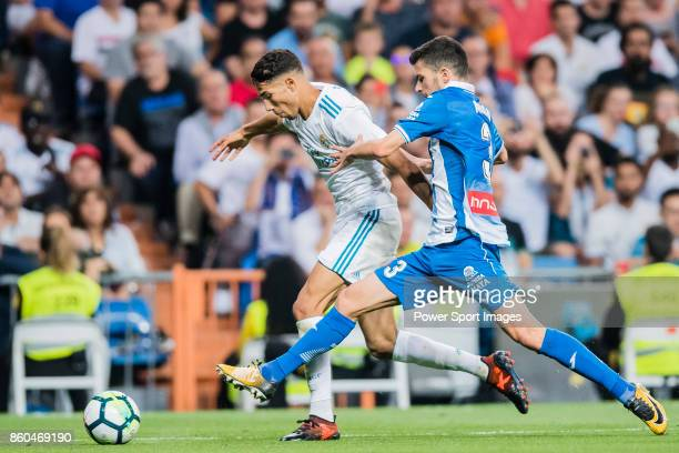 Achraf Hakimi of Real Madrid fights for the ball with Aaron Martin Caricol of RCD Espanyol during the La Liga 201718 match between Real Madrid and...