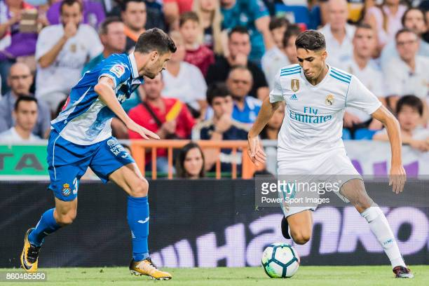 Achraf Hakimi of Real Madrid fights for the ball with Aaron Martín Caricol of RCD Espanyol during the La Liga 201718 match between Real Madrid and...