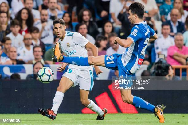 Achraf Hakimi of Real Madrid fights for the ball with Marc Roca Junque of RCD Espanyol during the La Liga 201718 match between Real Madrid and RCD...