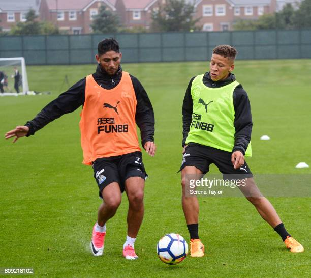 Achraf Lazaar and Dwight Gayle challenge for possession of the ball during the Newcastle United Training session at the Newcastle United Training...