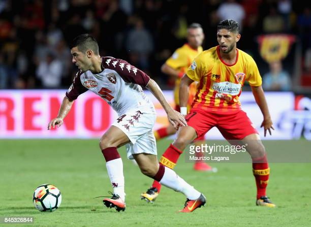 Achraf Lazaar of Benevento competes for the ball with Iago Falque of Torino during the Serie A match between Benevento Calcio and Torino FC at Stadio...