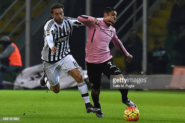 Achraf Lazaar of Palermo is callanged by Claudio Marchisio of Juventus during the Serie A match between US Citta di Palermo and Juventus FC at Stadio...