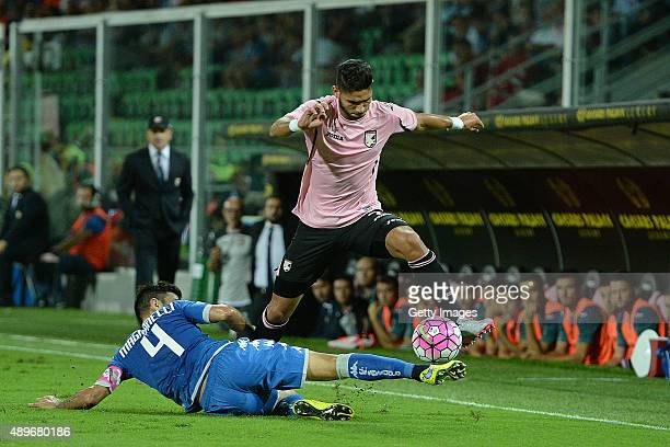Achraf Lazaar of Palermo jumps as Francesco Manganelli of Sassuolo tackles the Serie A match between US Citta di Palermo and US Sassuolo Calcio at...