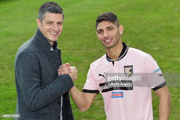 Achraf Lazaar poses with Team Manager Igor Budan before his presentation as new player of US Citta di Palermo at Tenente Carmelo Onorato Sports...