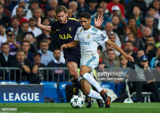 Achraf of Real Madrid competes for the ball with Jan Vertonghen of Tottenham Hotspur during the UEFA Champions League group H match between Real...
