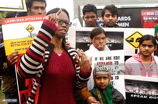 Acid attack victim Laxmi and other volunteers mobilizing support against acid attacks on January 22 2014 in New Delhi India Laxmi is hoping to bring...
