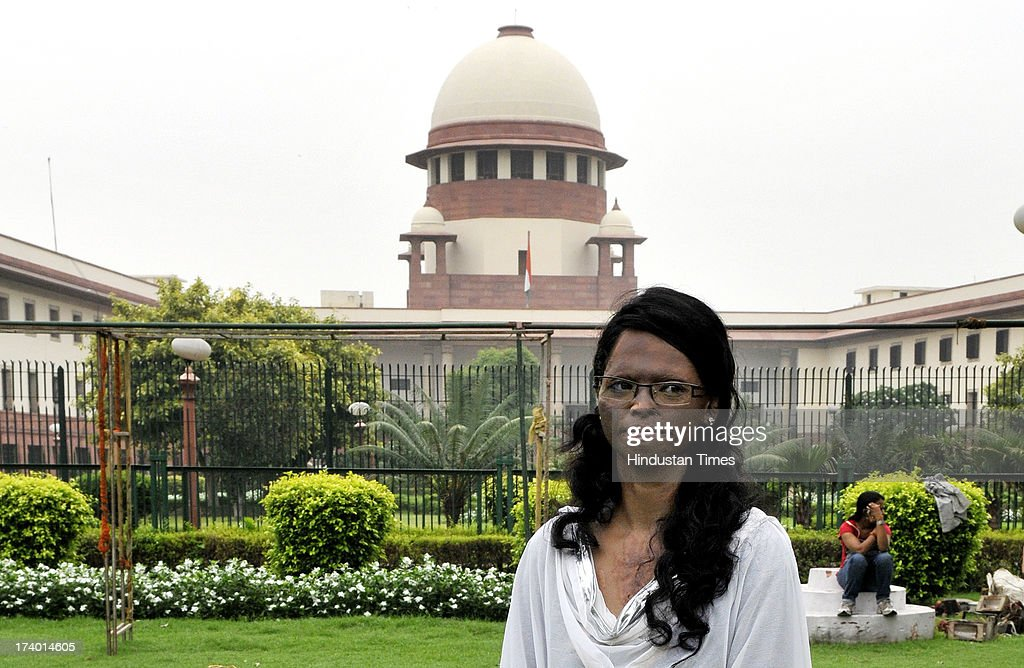 Acid attack victim Laxmi at Supreme Court after verdict on plea filed by her on the regulation of sale of the chemicals at the retail level on July 18, 2013 in New Delhi, India. Laxmi was attacked with acid by three men near Tughlaq road in New Delhi as she had refused to marry one of them. The Supreme Court directed States and Union Territories to frame rules to regulate sale of acids and other corrosive substances within three months and make acid attack a non-bailable offence. The court also directed that acid attack victims shall be paid a compensation of at least Rs. 3 lakh by the State Government concerned as an after-care and rehabilitation cost for such victims.