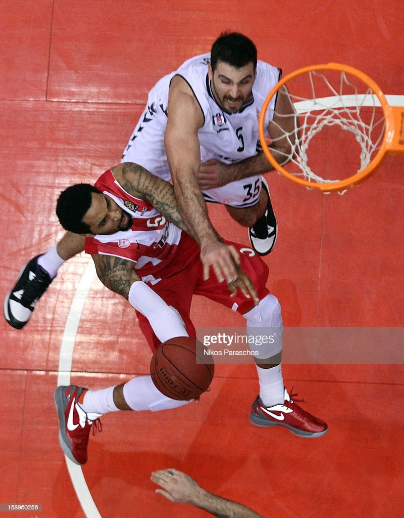 Acie Law, #5 of Olympiacos Piraeus competes with Nalga, #35 of Besiktas JK Istanbul during the 2012-2013 Turkish Airlines Euroleague Top 16 Date 2 between Olympiacos Piraeus v Besiktas JK Istanbul at Peace and Friendship Stadium on January 4, 2013 in Athens, Greece.