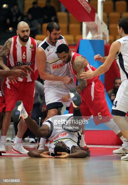 Acie Law #5 of Olympiacos Piraeus participates in a conflict with Romain Sato #10 of Fenerbahce Ulker Istanbul during the 20122013 Turkish Airlines...