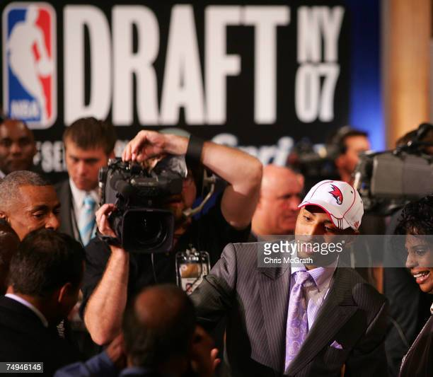 Acie Law IV of Texas celebrates after he was drafted eleventh by the Atlanta Hawks during the 2007 NBA Draft at the WaMu Theatre at Madison Square...
