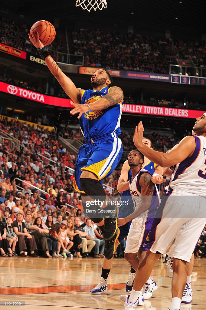 <a gi-track='captionPersonalityLinkClicked' href=/galleries/search?phrase=Acie+Law&family=editorial&specificpeople=801584 ng-click='$event.stopPropagation()'>Acie Law</a> #2 of the Golden State Warriors drives for a shot against the Phoenix Suns in an NBA game played on March 18, 2011 at U.S. Airways Center in Phoenix, Arizona.