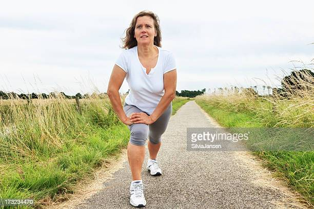 acive mature woman stretching exercise