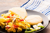This image was taken of a dish of Ackee and Salt Fish served with boiled dumplings and yams.