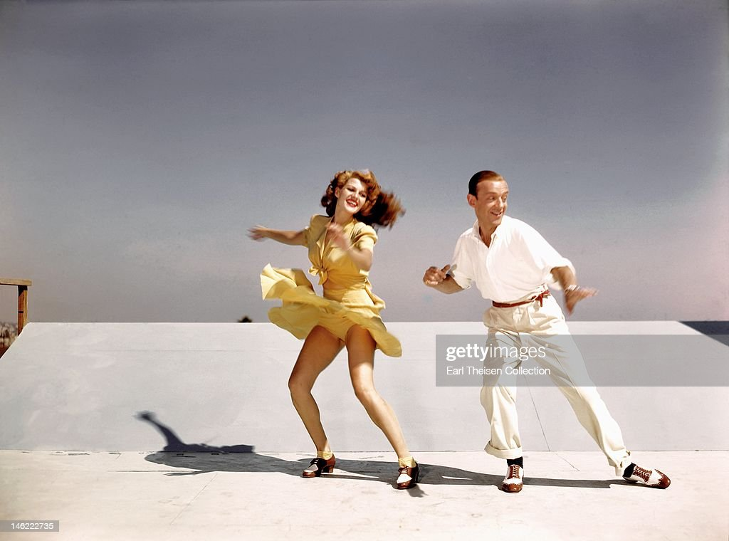 Acors and dancers <a gi-track='captionPersonalityLinkClicked' href=/galleries/search?phrase=Rita+Hayworth&family=editorial&specificpeople=70013 ng-click='$event.stopPropagation()'>Rita Hayworth</a> and <a gi-track='captionPersonalityLinkClicked' href=/galleries/search?phrase=Fred+Astaire&family=editorial&specificpeople=70031 ng-click='$event.stopPropagation()'>Fred Astaire</a> rehearse on a roof top at Columbia Pictures for a scene from their film 'You Were Never Lovelier' in 1942 in Los Angeles, California.