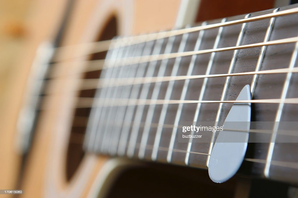 Acoustic Guitar and Pick : Stock Photo