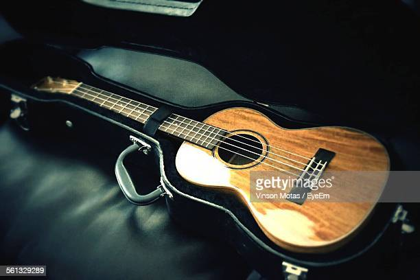 Acoustic Guitar In Case On Table