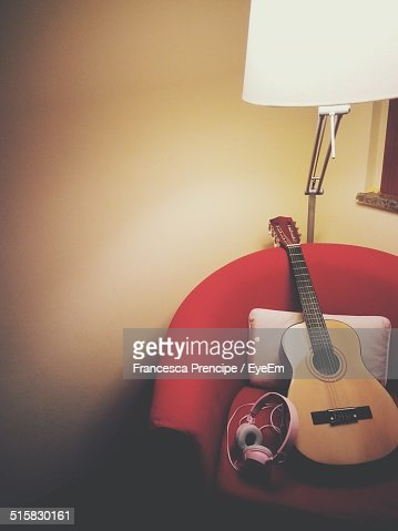 Acoustic Guitar On Chair At Home
