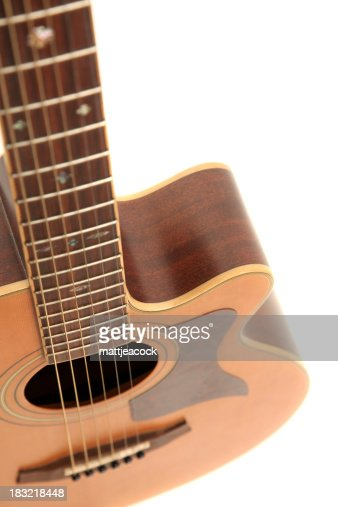 Acoustic Guitar Standing Upright With A White Background