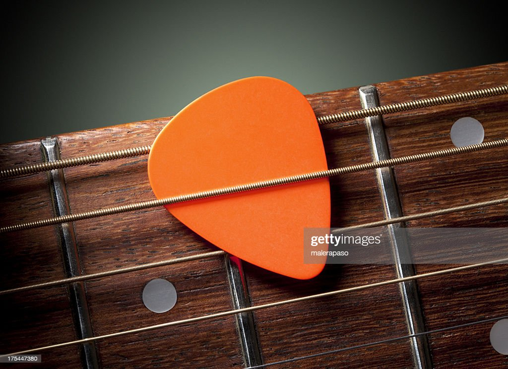 Acoustic guitar with pick