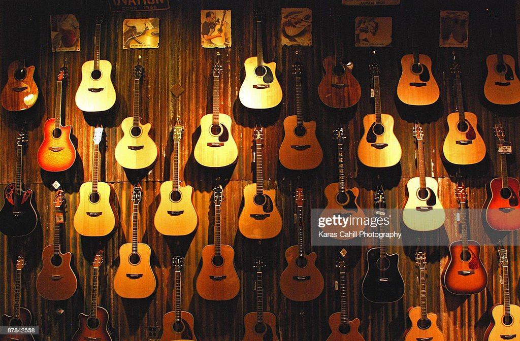 Acoustic guitars on a wall : Stock Photo