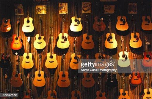 Acoustic guitars on a wall : Bildbanksbilder