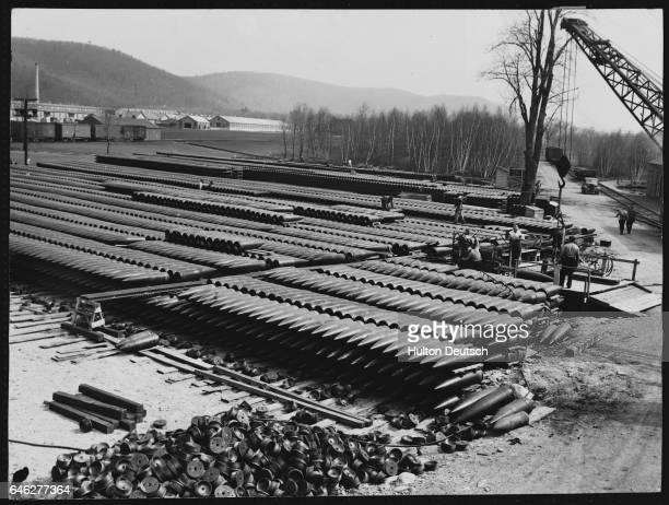 Acres of World War One shells of large caliber are salvaged for scrap at Picatinny special machines sever the copper rotating bands and remove them...