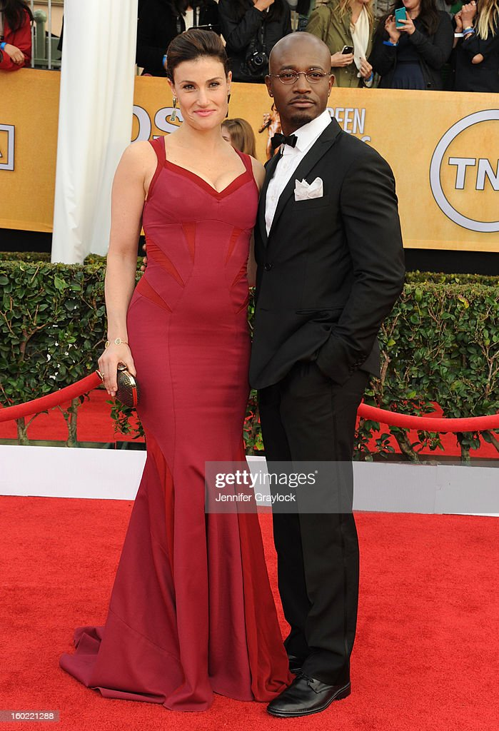 Acress Idina Menzel and her actor husband Taye Diggs arrive at the 19th Annual Screen Actors Guild Awards held at The Shrine Auditorium on January 27, 2013 in Los Angeles, California.