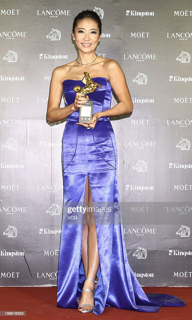 Acress Liang Jing poses with her trophy during the 49th Golden Horse Awards at the Luodong Cultural Working House on November 24, 2012 in Ilan, Taiwan.