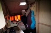 Acrobat Laura Ladbrooke does her warmup stretches in her tiny trailer as she warms up ahead of her performance with Mr Fips' Wonder Circus on April 7...