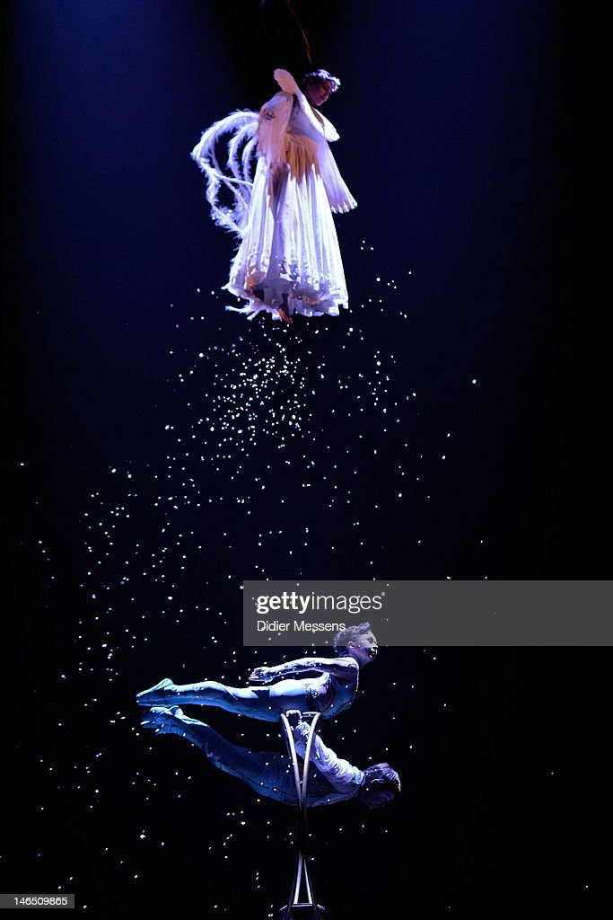 Acrobat performing a tender pas-de-deux using contortion and hand-balancing is performed by a duo of little people during the Belgian premiere of the Cirque du Soleil show Corteo on June 13, 2012 in Antwerpen, Belgium.