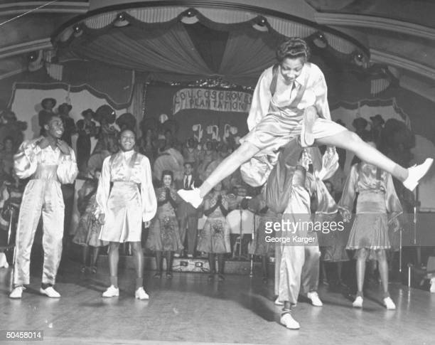 Acrobatic dancers performing onstage at the Cotton Club
