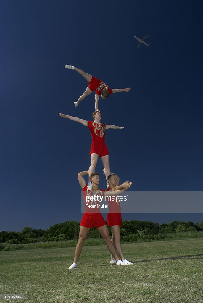 Acrobatic troop performing moves : Stock Photo