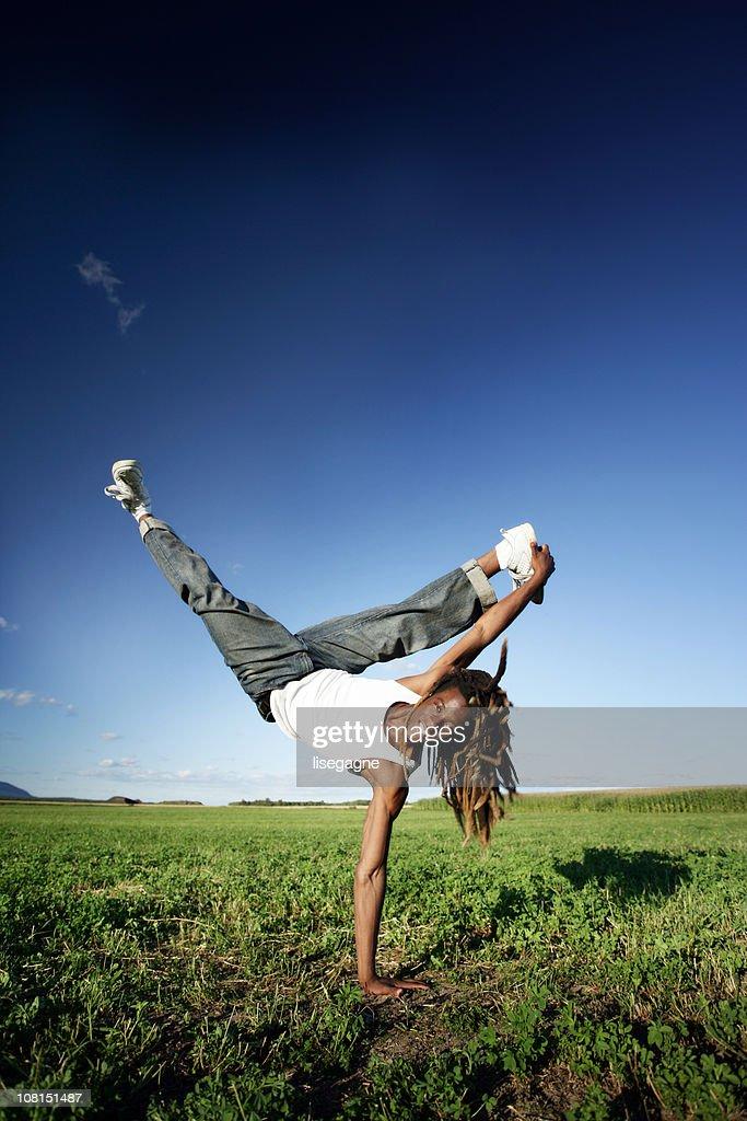 Acrobatic young man : Stock Photo