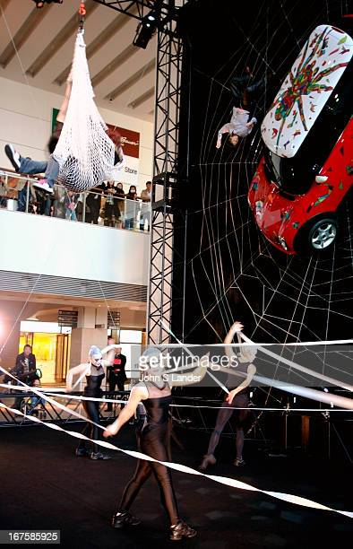 Acrobats and performers advertising the Mini Cooper at Queen's Square shopping mall at Minato Mirai or 'Future Port' in Yokohama Minato Mirai is...