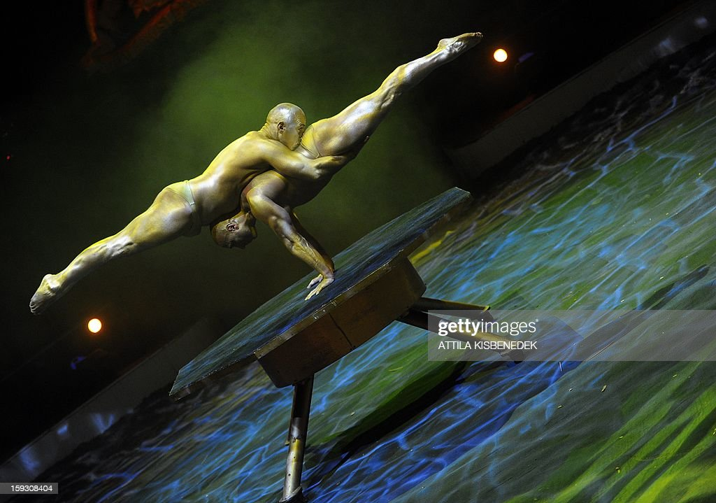 Acrobats of the Hungarian 'Golden Power' team perform on the circus floor of the Grand Circus of Budapest on January 11, 2013 during a rehearsal of the of a new production, title the 'Hungarian circus stars'. The premiere will be held on January 12. AFP PHOTO / ATTILA KISBENEDEK