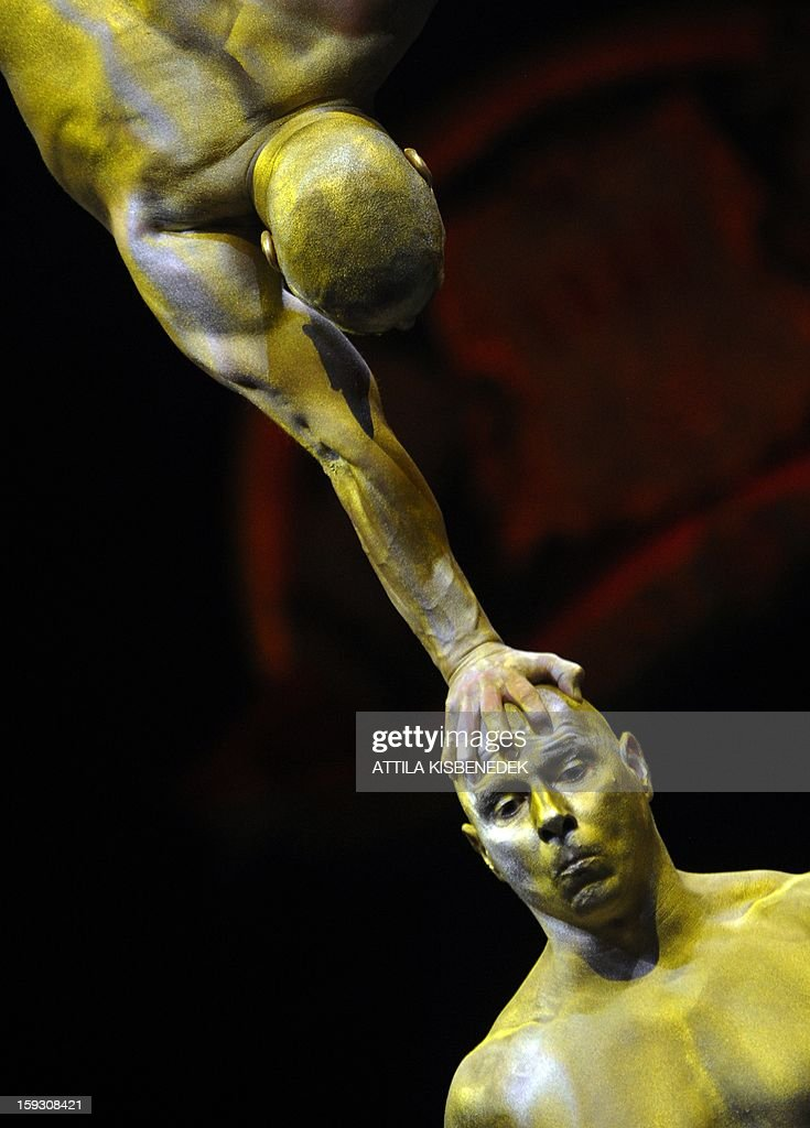Acrobats of the Hungarian 'Golden Power' team perform on the circus floor of the Grand Circus of Budapest on January 11, 2013 during a rehearsal of the of a new production, title the 'Hungarian circus stars'. The premiere will be held on January 12.