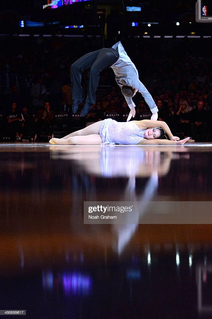 Acrobats perform during halftime of a game between the Detroit Pistons and the Los Angeles Lakers at Staples Center on November 17, 2013 in Los Angeles, California.