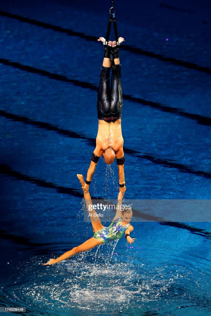 Acrobats perform during the Opening Ceremony of the 15th FINA World Championships at Palau Sant Jordi on July 19, 2013 in Barcelona, Spain.