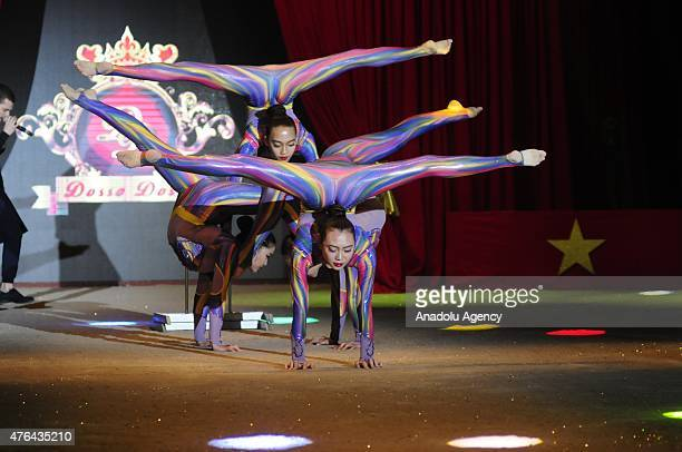 Acrobats performs a show during the 20th Dosso Dossi Fashion Show in Antalya Turkey on June 09 2015