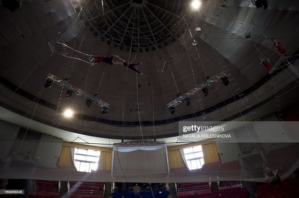 Acrobats rehearse in a circus in the Russian Black Sea resort of Sochi, on February 8, 2013.