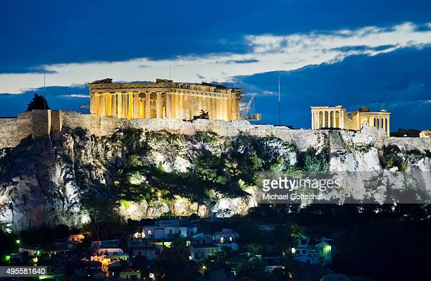 Acropolis or Akropolis fortress seen behind buildings of the city of Athenss on October 29 2015 in Athens Greece