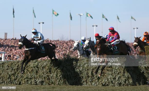 Across The Bay and Balthazar King in action during the John Smith's Grand National Chase during Grand National Day at Aintree Racecourse Liverpool