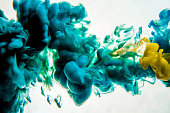 Acrylic colors and ink in water. Abstract frame background. Isolated on white