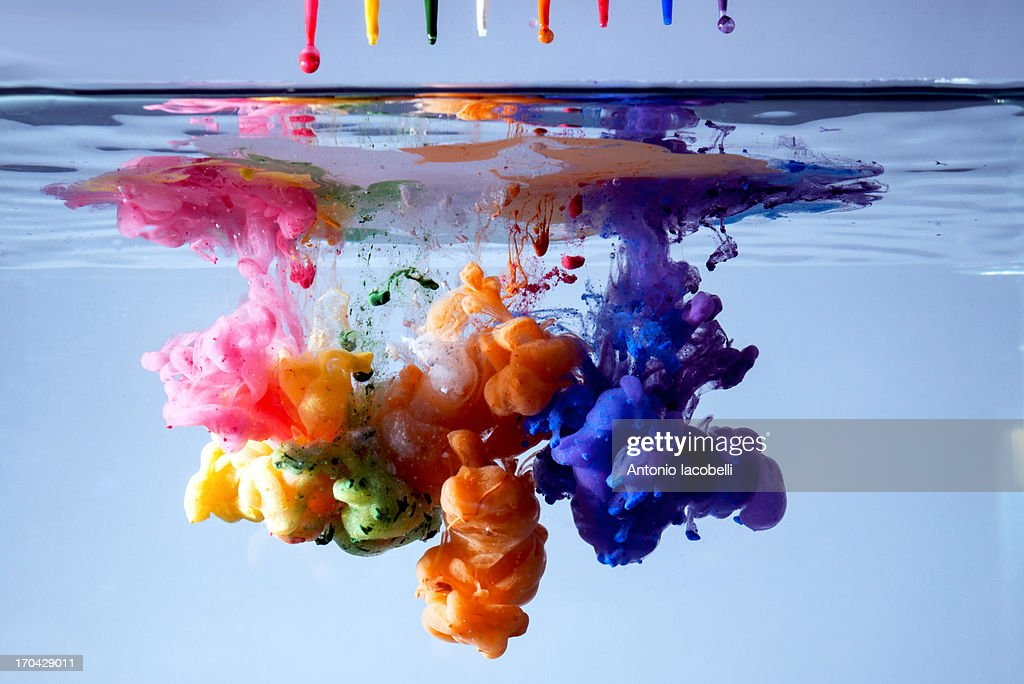 Acrylic paints in water : Stock Photo
