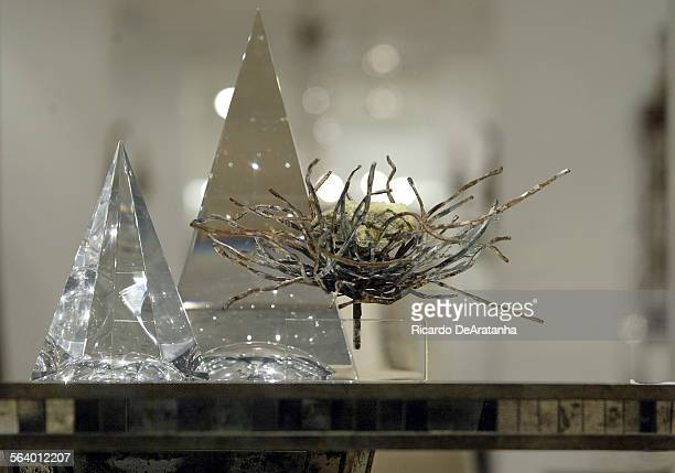 Acrylic prism towers and raw iron nest on a mirror tiled table at Niermann Weeks showroom The showroom is being set up for Westweek a major industry...