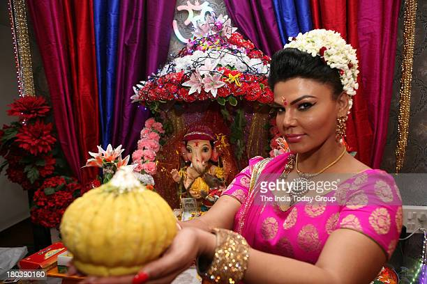 Acteress Rakhi Sawant during Offering Puja at home on occasion first day ganesh Festivalat mahim on 9th September 2013 in mumbai