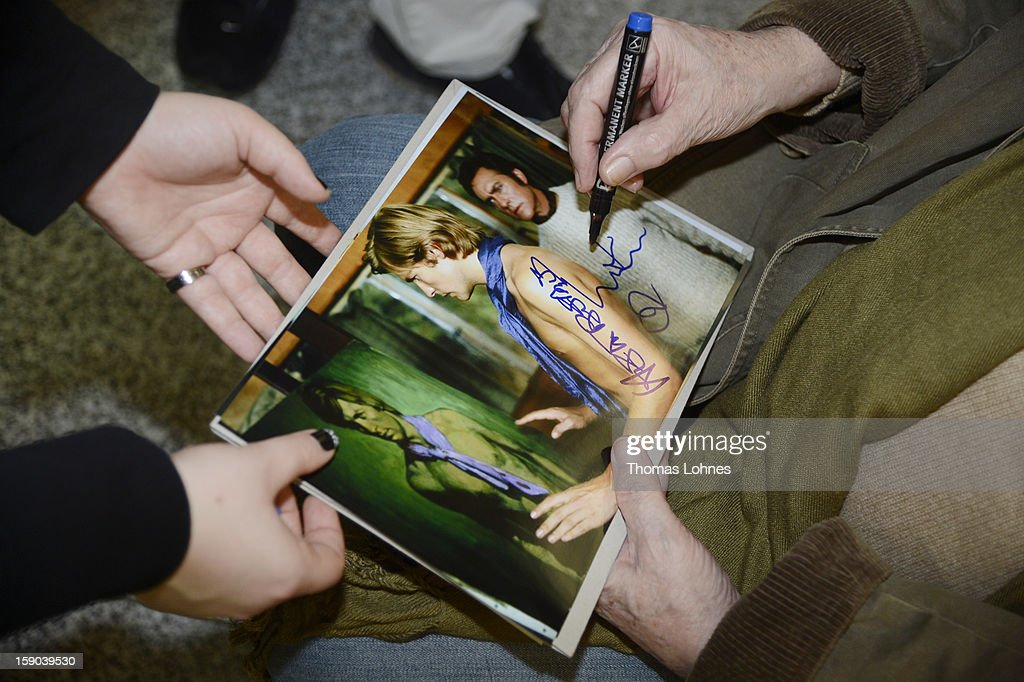 Acteur Helmut Berger sign autographs at Frankfurt airport before the flight to Australia on January 6 2013 in Frankfurt am Main Germany They are...
